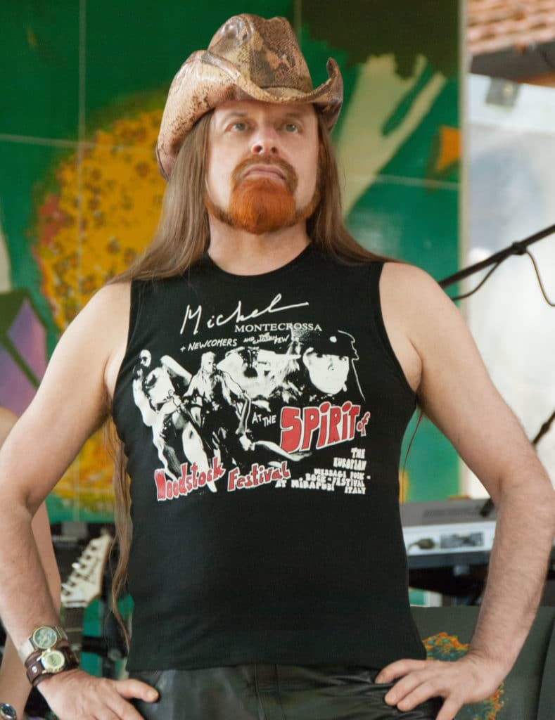 Michel Montecrossa wearing Spirit of Woodstock Festival T-Shirt